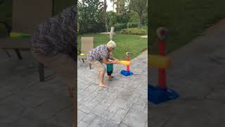 Great grandma teaches kid to play Tball/baseball