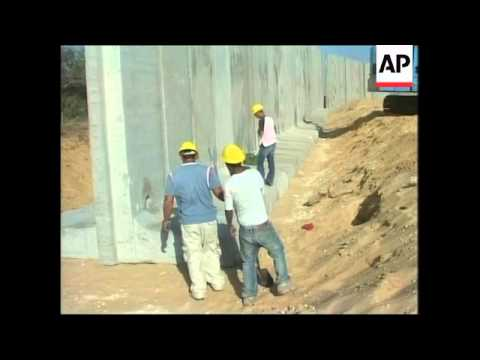 Israeli government building separation wall on Gaza border