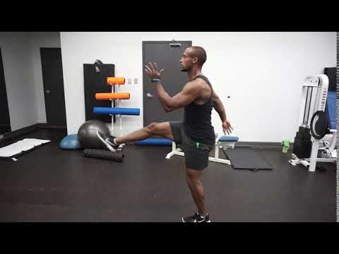 Stationary high stepping alternating sprint kicks (side view)