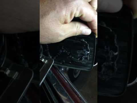 How to fix a Side review mirror on a 1991 Cadillac Fleetwood