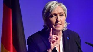 Le Pen refuses headscarf, cancels meeting