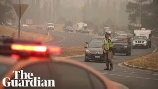 Australia fires: risk of more extreme weather leaves people unsure whether to flee or stay