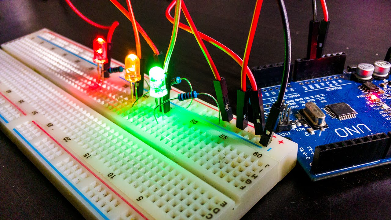 Breadboard with Arduino Uno and few LEDs wired up