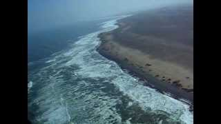 Wilderness Air Cessna 208 Caravan Landing in Skeleton Coast Camp, Namibia