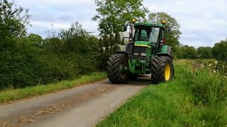 Drawing silage bales with John Deere 7810 and John Deere 6620 20