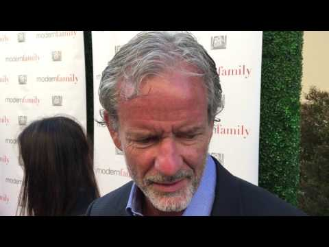 """Co-creator Christopher Lloyd chats on the """"Modern Family"""" red carpet for an Emmy voter FYC screening"""