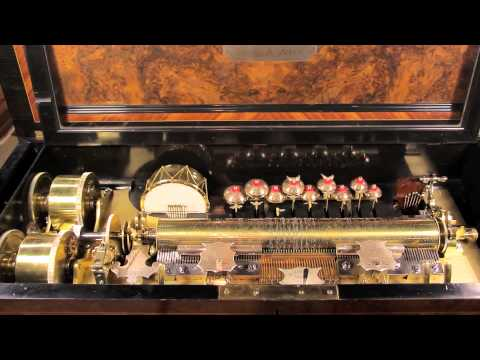 A Swiss Burlwood and Ebonized Interchangeable Cylinder Music Box with Cabinet, Ami Rivenc