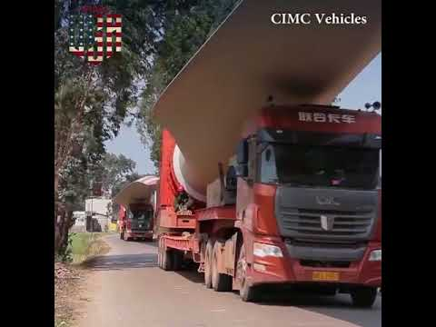 Trucks Carrying Wind Turbine Blades To The Mountaintop