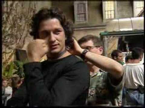 Gerard butler behind t... Gerard Butler