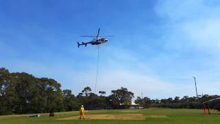 NSWRFS - Helicopter landing after putting out fires
