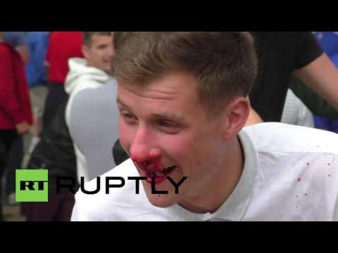 France: England fan tips his drink on child begging for money