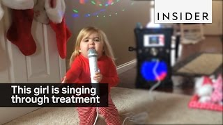 This 7-year-old is singing and dancing her way through treatment