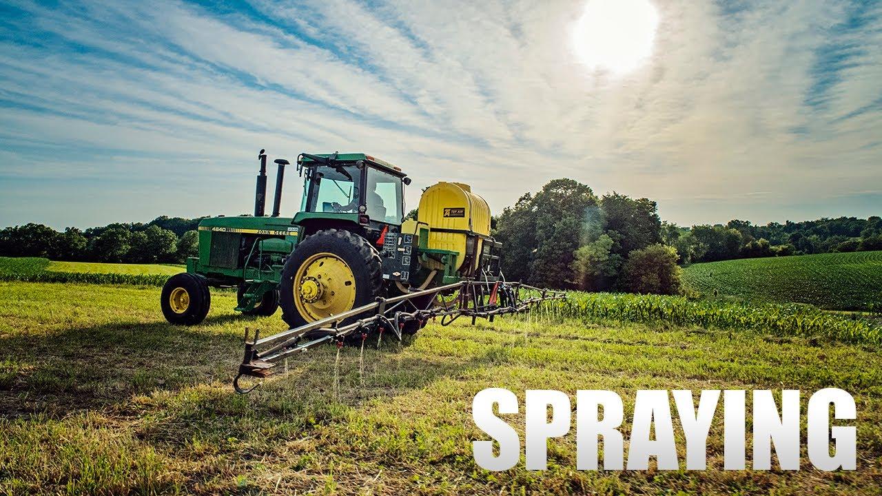 Spraying 32% Nitrogen on Hay - Top Air Sprayer