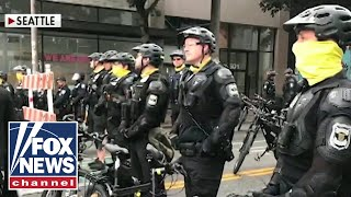 Seattle City Council approves plan to defund police department