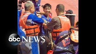 Trapped crew members rescued from capsized cargo ship l ABC News