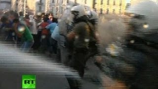 Video: Muslims in Greece tear-gassed in Mohammed film & cartoon protest(At least 40 people were detained in Athens after approximately 600 protestors clashed with police on Sunday as they tried to approach the US embassy in ..., 2012-09-24T10:39:41.000Z)