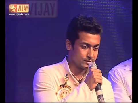 Surya having posters of Kamal with words GOD