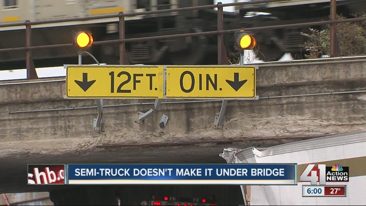 Semi-truck driver tries his luck in tight squeeze overpass, gets stuck
