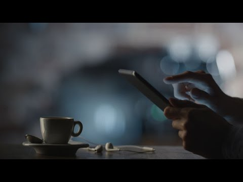 Man Using Tablet PC in Cafe | Stock Footage - Videohive