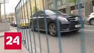 Нелегальные парковщики: откуда приходит человек с 'заборчиком'