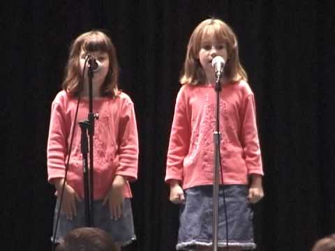 My Daughter and her friend at the talent show singing a duet