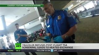 TSA officers try to screen passenger after his flight, threaten him after refusal