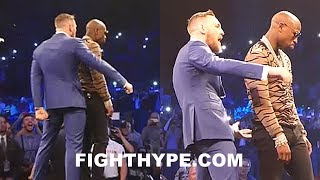 CONOR MCGREGOR TAUNTS MAYWEATHER AS HE DANCES UP ON HIM TO SPANK DAT ASS