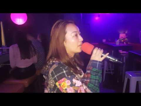 Yumi-Chan singing Karaoke at Wang Chung's Waikiki