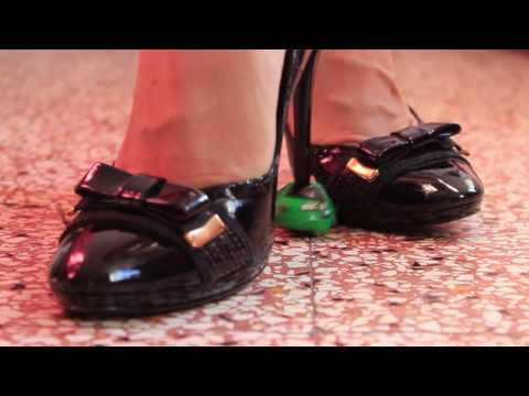Crushing toy car with black high heels
