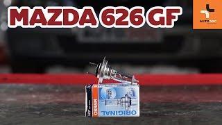 Hoe een lamp van een koplamp vervangen op een Mazda 626 GF HANDLEIDING | AUTODOC