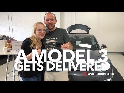 A Model 3 gets delivered