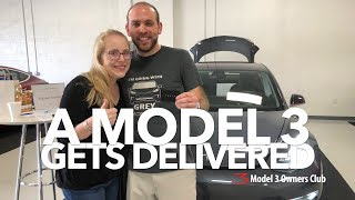 A Model 3 gets delivered