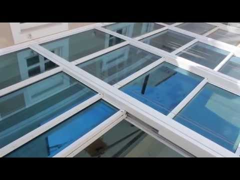 GLASSCON GmbH - RETRACTABLE GLASS ROOF WITH BULLET-PROOF GLASS & EXTERNAL SOLAR SHADES