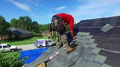A.J. Wells Roofing Contractors Jacksonville Florida roof replacement installing shingles