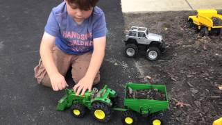 Kids Tonka dump truck and John Deere Tractor Loader and Hauler toy moves dirt and rocks -