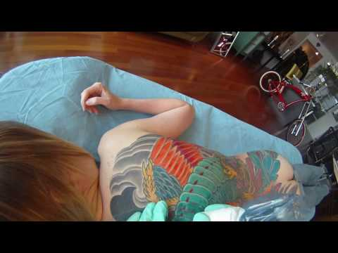 Adam Sky tattooing a phoenix PT01