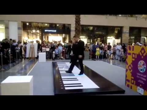 jingle bells playing in a big piano by foot