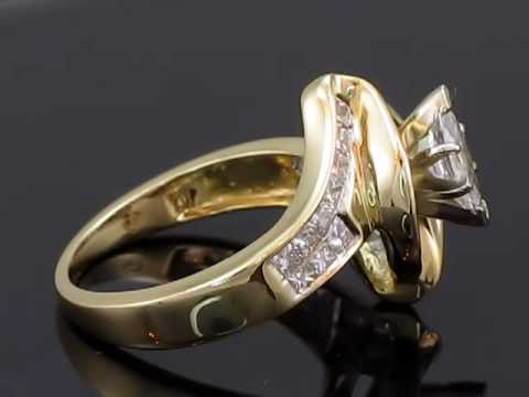 1.65 CT T.W. Marquise Diamond Ring with Princess and Baguettes in 14K Yellow Gold