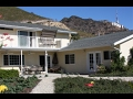 House under Hollywood Sign for sale or rent. Stunning aerial film