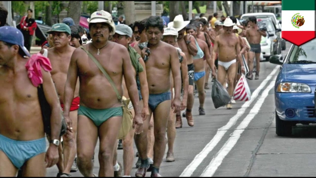 Nude people march during a massive protest rally against