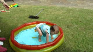 Millie falls over in paddling pool Thumbnail