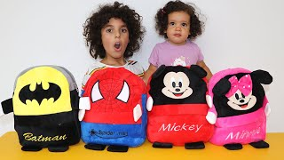 Sami and amira learn colors with superhero bags - Spider-Man Batman Mickey and Minnie