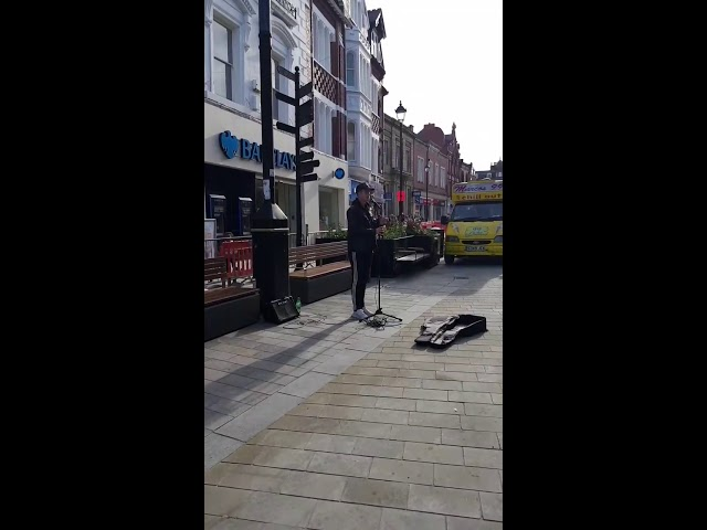 Guy singing Oasis Wonder Wall in Wrexham town Centre