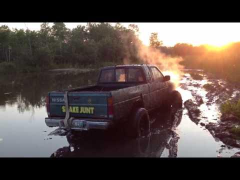 Muddin a 4x4 Nissan hard-body