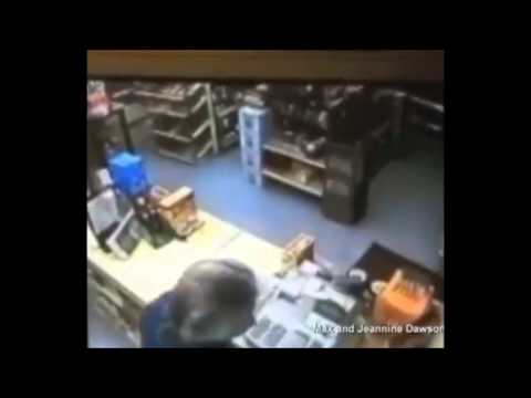 Download Robber pulls gun on wrong clerk, Iraq war vet shoves 9mm to his mouth 'Caught on tape'