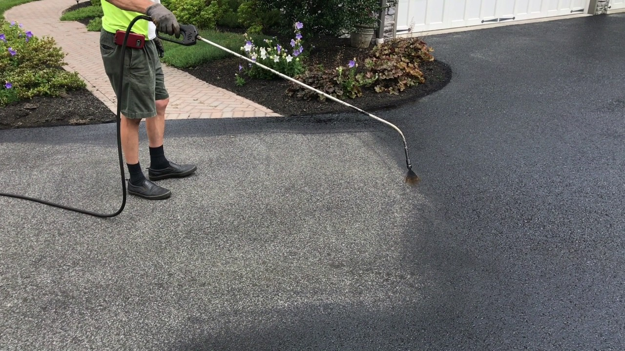 Sealcoating the driveway with oil based sealer the right for Can i paint asphalt driveway