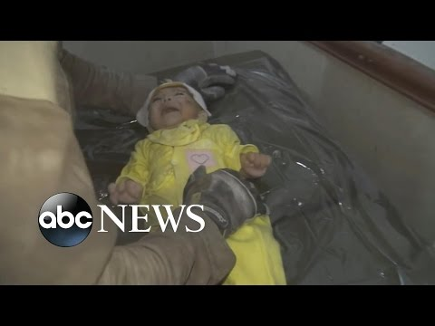 Rescue Worker Cries after Pulling Baby From Rubble in Syria