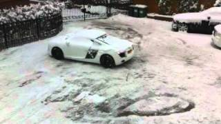 16 year old clearing his driveway of snow in an Audi R8