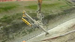 Long reach excavator on soil nailing
