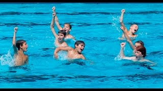 A group of boys from Beaconsfield Heights pool boys perform a synch...